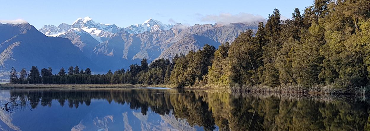 Foto vom Lake Matheson mit Mount Tasman und Mount Cook